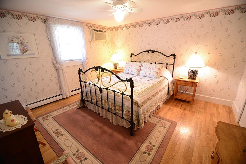 Leland suite bedroom with queen bed
